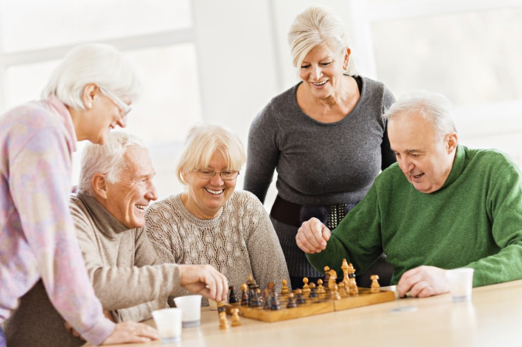 Elderly group playing chess